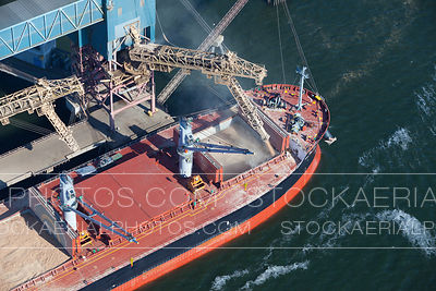 Cargo Ship Being Loaded with Grains