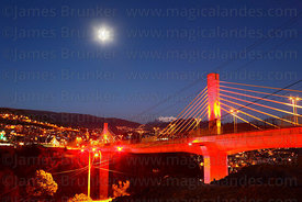 Illuminations on Triple Bridge / Puente de los Trillizos at sunset and full moon, La Paz , Bolivia
