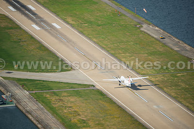 Aerial view of plane taking off at City Airport, London