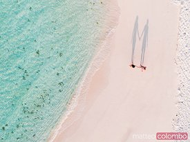 Aerial view of couple on a sandy beach, Maldives