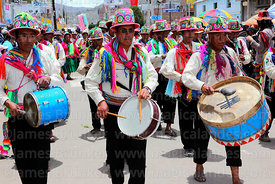 Musicians from Lampa village wearing traditional dress , Virgen de la Candelaria festival, Puno, Peru