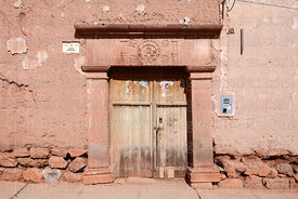 Stone carvings on colonial doorway, Maras, Cusco Region, Peru