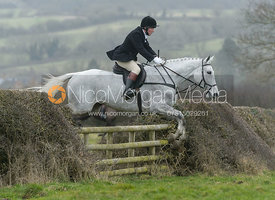 Dick Wise jumping a hedge at Leicester Lane