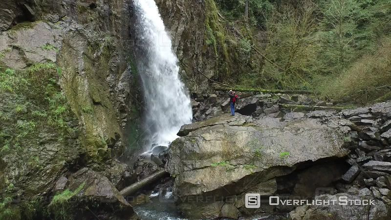 Aerial Footage of Backpacker Taking Photos of Waterfall Oregon USA