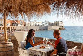 Couple driking in a bar in Gallipoli, Salento, Apulia, Italy