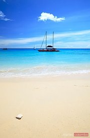 Tropical beach and yacht in the Barbados, Caribbean