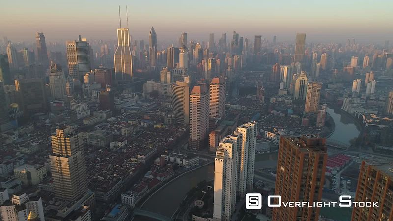 Shanghai Skyline in the Sunny Morning. Puxi District. China. Aerial High Altitude View. Drone is Flying Backward. Establishing Shot.