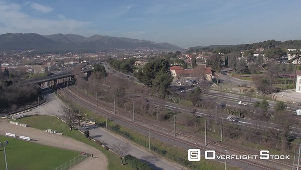 Aerial view of a Train arriving to Aubagne, filmed by drone, France
