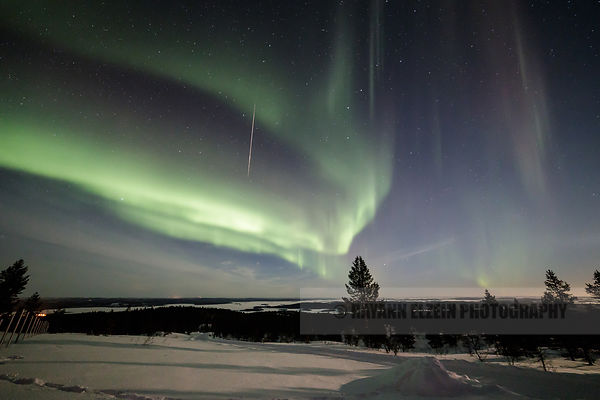 Shooting star and Aurora Borealis in Lapland