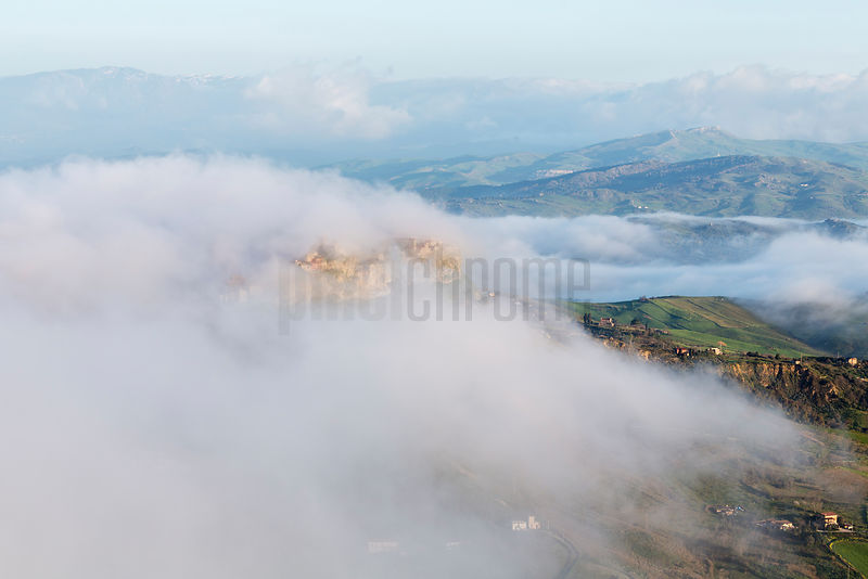 View of Calascibetta in the Fog at Dawn
