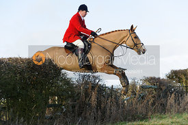 Richard Hunnisett jumping a hedge near Hill Top Farm