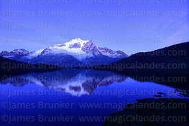 Mt Huayna Potosí reflected in lake before dawn, Cordillera Real, Bolivia