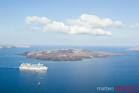 Cruise liner ship near volcanic island in Santorini, Greece