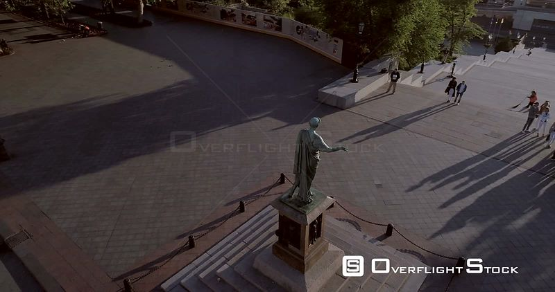 Aerial camera makes a cinematic circle around the Duc Richelieu statue on Prymorski Boulevard, Odessa Ukraine