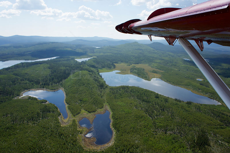 Aerial view of lakes in the Northern Rockies from a de Havilland Canada DHC-3 Otter Turbo, Muskwa-Kechika Protected Area, British Columbia, Canada, July 2011 .