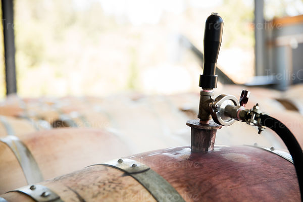 Close-up of oak barrels being sanitized with hot water and steam