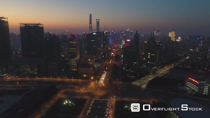 Shanghai Skyline at Twilight. Lujiazui District and Century Avenue. Aerial View. Drone is Flying Forward and Upward. Establishing Shot.
