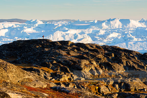 Lone man exploring the landscapes of the Ilulissat Icefjord in Greenland