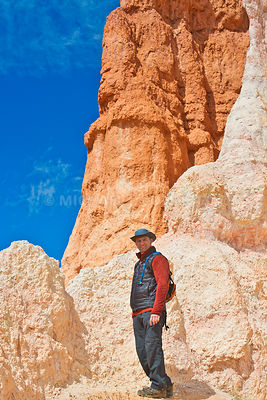 Hiker Among The Hoodoos- Bryce Canyon, Utah