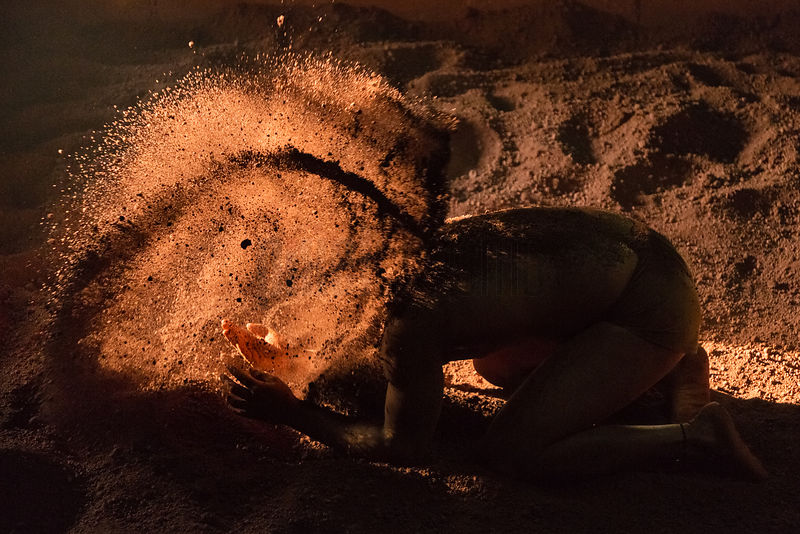 Kushti Wrestler Applying Red Sand to his Body