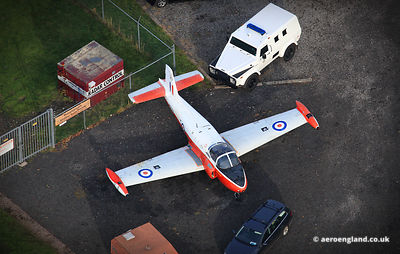 aerial photograph of a Jet Provost at Hack Green secret nuclear bunker in Cheshire. England UK