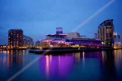 Quays Theatre Illuminated across the Ship Canal at Dusk (diffused)