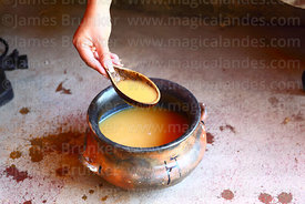 Bowl of chicha / traditional maize beer and tutuma for serving, Bolivia