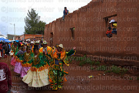 Ch'utas dancing with cholitas in street at San Antonio de Abad festival in Caquiaviri, Bolivia