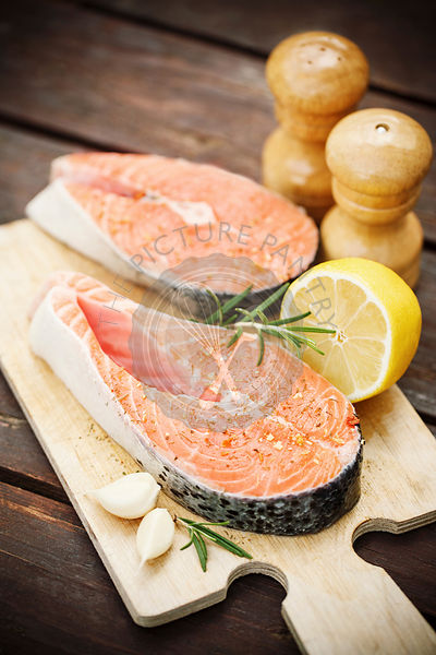 Two fresh salmon steaks with spices and herbs