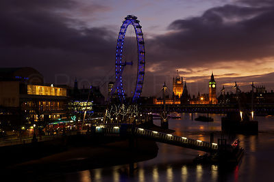 The London Eye and The Houses of Parliament against a golden sky