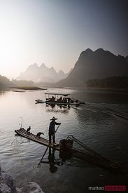 Old chinese fisherman on Li river, Guilin, China
