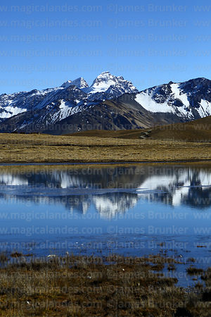 Mt Condoriri reflected in partly frozen lake, Cordillera Real, Bolivia