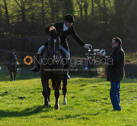 Follower taking a drink at the meet - The Belvoir Hunt at Stonesby, 19/12