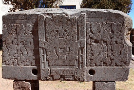 Viracocha / Wiracocha figure in form of Sun God showing rays around head on stone block outside museum, Tiwanaku , Bolivia