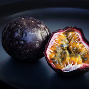 Passion fruit on black plate