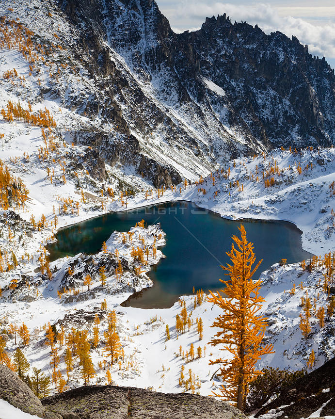 Enchantment Lakes in early winter snow with Larch trees bearing  autumn leaves,   Alpine Lakes Wilderness, Central Cascade range, Washington, USA, November 2011.