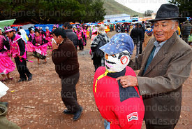 Man holding dummy to be used in bullfight at festival in Caquiaviri, Bolivia