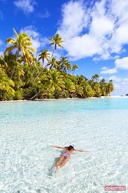 Woman snorkeling in the blue sea of One Foot Island, Aitutaki, Cook Islands