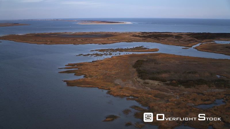 Low over water and marshy islands, crossing Little Egg Inlet, New Jersey. Shot in November