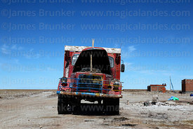 Vintage Volvo truck, brick house under construction in background, Colchani, Bolivia