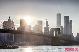 Brooklyn bridge and lower Manhattan skyline at sunset, New York, USA