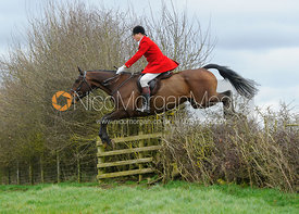 Nicholas Leeming jumping a hedge above Klondike