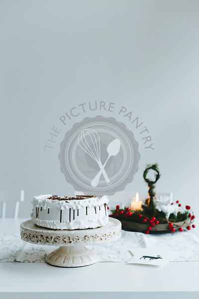 Cake on the white table with Christmas decoration