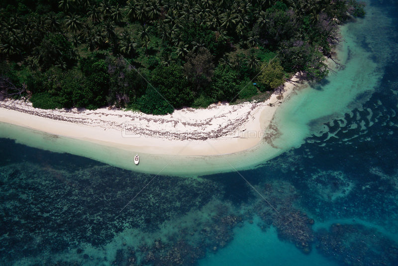 Aerial view of island shoreline showing land, sea and coral reef, Seychelles, Indian Ocean