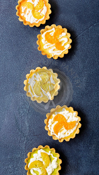 Lemon tarts with candied lemon, lime and orange slices