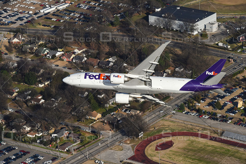 Fed Ex Boeing 777 Flying over Memphis Tennessee,air-to-air aerial photo