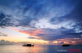Dhoni traditional maldivian boat at sunset, Maldives