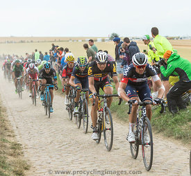 The Peloton on a Cobblestones Road - Tour de France 2015