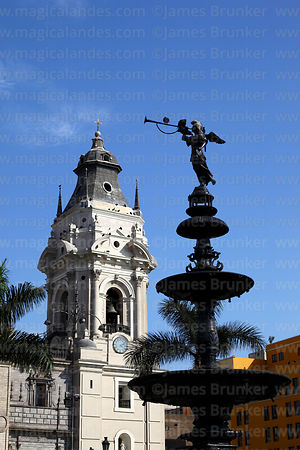 Fountain and tower of cathedral, Plaza de Armas, Lima, Peru