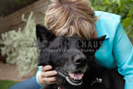Woman-Hugging-Black-Shepherd-With-Face-Buried